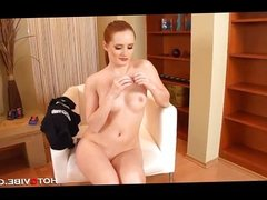 Super hot redhead plays with her pussy