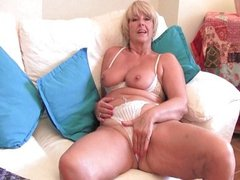 Granny with big tits rubs her pussy