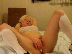 Sexy Blonde School masturbates with her toy