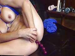 Double penetrating herself on cam