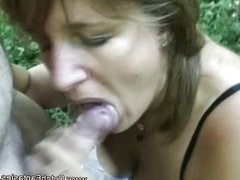 Horny MILF fucking in the forest