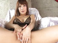 Riona Suzune is oiled up while she masturbates