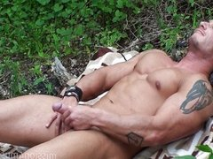 Muscle god stroking his dick