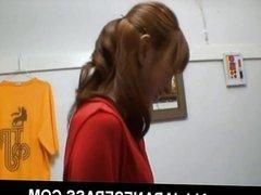 Rine Ogura in her uniform using her hands