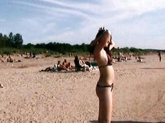 Lovely teens bare their bodies at a nudist be