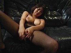 Big tits Asian babe inserting toy