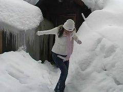 Horny girl fucking snow dildo