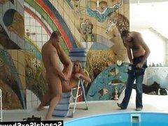 Couple having sex near a pool