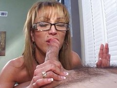 Mature slut blowing cock with glasses