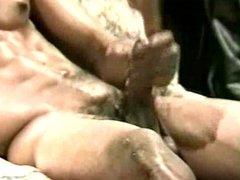 Muscular black guy rubbing cock