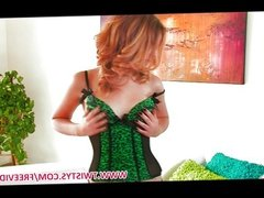 Beautiful lingerie clad redhead strips down