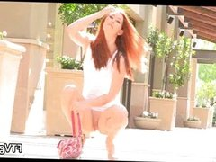 Hot babe Melody is walking outside
