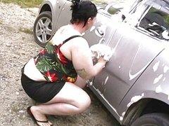Milla gets wet washing her car