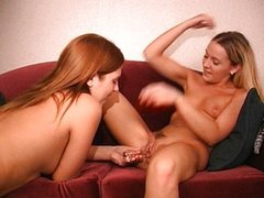Two hot chicks playing with each other