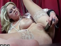 Busty pornstar in sexy stockings toying her puss