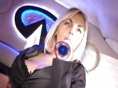 Seductive blonde enjoys anal masturbation in limo