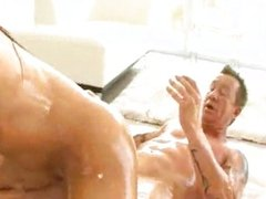 Tanned oiled brunette sucking and fucking