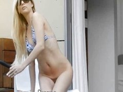 Blonde woman in glasses dildoing snatch