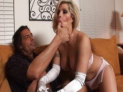 Brooke gives gloves handjob