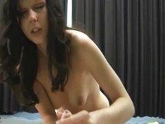 Hot brunette babe gives hot handjob