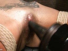 Tattooed Beauty Works for Her Orgasm