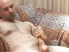 Bald poof jerking off his cock