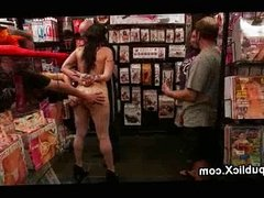 Bound busty babe spanked in porn store