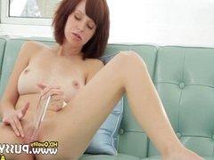brunette toying her vagina on sofa