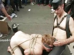 Gay slave tied with leather in group sex