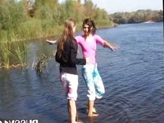 Young beauties fingering by the river