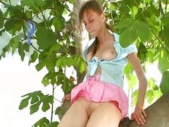 titty brunette pissing o the tree