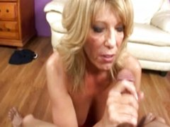 Hungry mature blonde gives great handjob