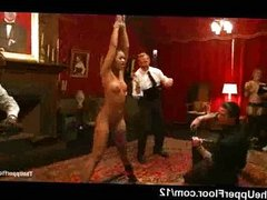 Bound black babe spanked at orgy party