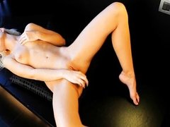 Blonde angel beauty on the leather sofa