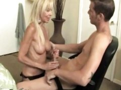 Thirsty milf gives hard tug and uses oil