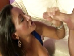 Busty mature milf gives handjob