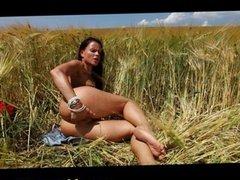 Jo masturbates outdoors in a field of wheat