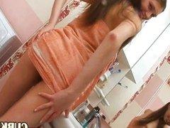 strip brunette in the bathroom