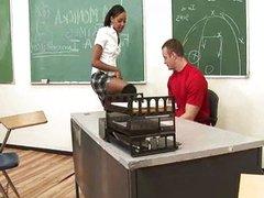 Ebony teen rides cock in classroom