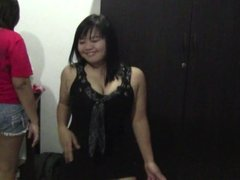 two funny thaigirls kissing in hotelroom