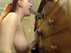 Busty redhead deepthroats dildo on webcam