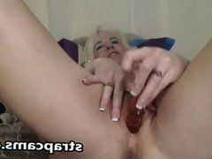 Gorgeous blonde granny titfuking with sexToy