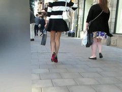 Young Lady in Short Skirt and Heels showing Nice Ass Cheeks
