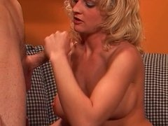 Mature hottie spreads her legs for a big cock