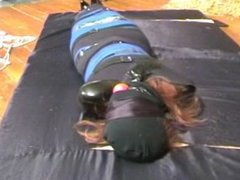 Jade mummified and gagged in straps