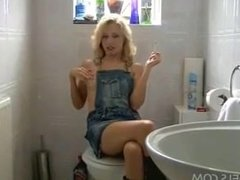 Blonde smokes while fingering in bathroom