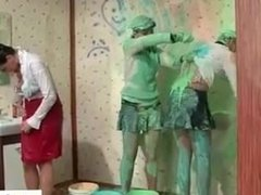 WAM scene with girls spreading paint on their bodies