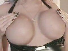 Busty blonde sucks cock