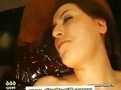 Piss drinking slut gets a goldenshower and sucks cock in gangbang