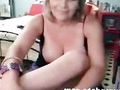 Mature babe with big tits teasing on webcam